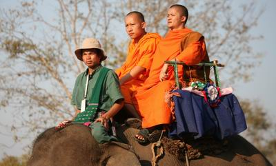 Monks enjoying elephant ride